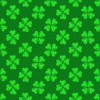 Seamless pattern with green hearts — Vektorgrafik