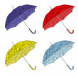 Colorful painted umbrellas — Stock Vector