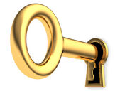 Golden key in keyhole — Stockfoto