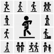 Stock Vector: Walking vector icons set on gray