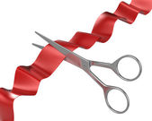 Scissors cut ribbon — Stock Photo