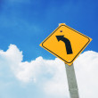 Turn left sign on blue sky — Stock Photo