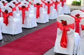 Wedding chairs and red carpet. — Stock Photo