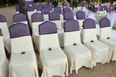 Wedding chairs decorated in white and violet color. — Stock Photo
