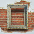 Classic frame on grunge brick wall background. — Stock Photo