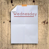 Wednesday planning on white fold paper with grunge retro wall pa — Stock Photo