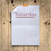 Schwenken sie samstag planung auf weiße falten papier mit grunge retro wand — Stockfoto