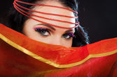 Fashoin portrait of arabian belly dancer with bright makeup — Stock Photo
