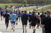 Runners all over the road — Stock Photo