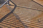Iron fence shadows — Stock Photo