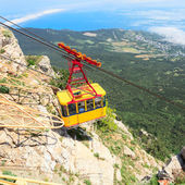 MISHOR, CRIMEA, UKRAINE - MAY 12. People travel by rope way cab on top of Ai-Petri Mountain on May 12, 2013 in Mishor, Ukraine.Russia. This road has one of the longest unsupported span in Europe. — Stock Photo