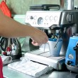 Woman make a cup of coffee by coffee machine — Stock Photo