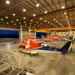 Stock Photo: Helicopters are parking in hangar