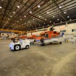 Helicopter in the hangar is prepared for morning flight — Stock Photo