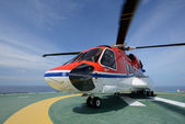 The S92 helicopter park on oil rig — Stock Photo