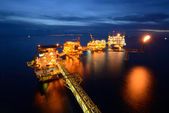 The large offshore oil rig drilling platform at night — Stock Photo