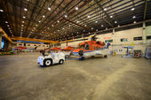 Helicopter in the hangar is prepared for morning flight — 图库照片