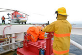 Fireman is guarding for offshore helicopter — Stock Photo