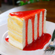 Crepe cake with strawberry sauce — Stock Photo