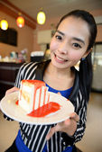 The beautiful smiling asian woman with a cake — Stock Photo