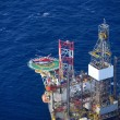 Stock Photo: Helicopter embark passenger on offshore oil rig.