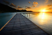 The beautiful wooden pier with sunrise at Rayong, Thailand — Stock Photo