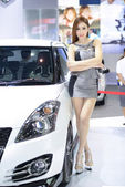 Beautiful female presenters model of motor show — Stock Photo