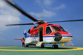 The helicopter is landing to embark passenger at oil rig platfor — Stock Photo