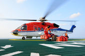 The helicopter landing officer loading baggage to helicopter at  — Stock Photo