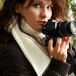 Stock Photo: Woman holding camera