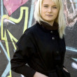 Girl on graffiti background — Stock Photo