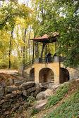 Arbor in autumnal park — Stock Photo