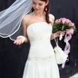 Stock Photo: Lovely bride with bouquet
