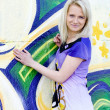 Girl on graffiti background. — Stock Photo #14286919