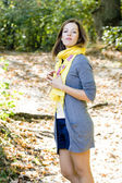 Woman in yellow scarf in autumn colors — Stock Photo