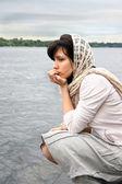 Woman near waterside — Stock Photo