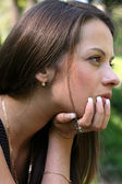 Woman rest her chin on her hand — Stock Photo