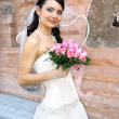 Lovely bride with bouquet — Stock Photo