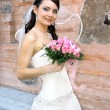 Lovely bride with bouquet — Stock Photo #19622743