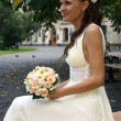 Lovely bride with bouquet — Stock Photo #51303867