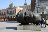 Sculpture on the Main Square in Cracow — Stock Photo