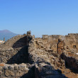 Stock Photo: Ruins of Pompeii Vesuvius in background