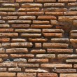 Royalty-Free Stock Photo: The ancient masonry of flat red bricks
