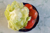Cabbage and tomatoes on a plate — Stock Photo