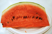 A piece of ripe watermelon — Stockfoto
