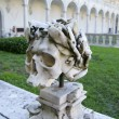 The skull on the portico of the monastery - Stock Photo