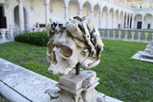 The skull on the portico of the monastery — Stock Photo