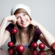 Beautiful woman with christmas bauble — Stock Photo #11988997