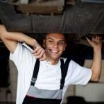 Car mechanic repairing auto — Stock Photo #12506288