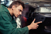 Close-up of damaged car inspected by mechanic — Stock Photo